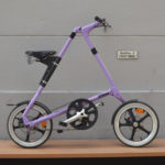 "Used STRiDA LT 16"" lavender with white tires and leather saddle and handle bars."