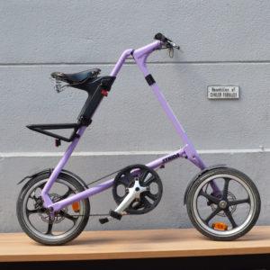 Brugt STRiDA LT lavendel med16'' hjul og læder-saddel og -håndtag.